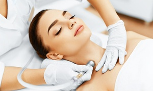eMVee Spa: Facial and Glass of Champagne or Wine with Optional Microdermabrasion at eMVee Spa (Up to 73% Off)