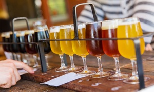 Unwined Bar & Bistro: Wine or Beer Flight with Meat and Cheese Boards for Two or Four at Unwined Bar & Bistro (Up to 52% Off)