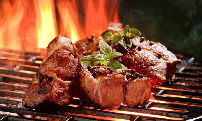 RawHide Steakhouse & Saloon - Rawhide Steakhouse & Saloon: $60 for a Four-Course Steakhouse Dinner for Two at RawHide Steakhouse & Saloon (Up to $125 Value)