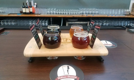 Beer Flight, Pint, Logo Growler, and Koozie for One, Two, or Four at Mistress Brewing Company (Up to 45% Off)