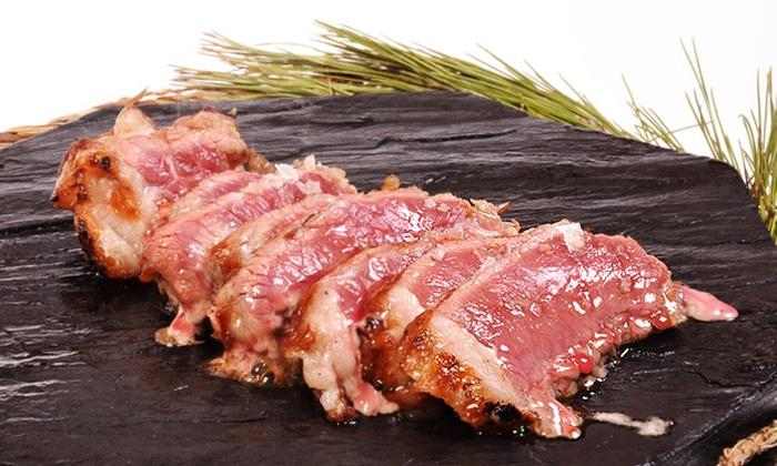 Algarrobo - Algarrobo: Menú de Carne a la piedra para dos, con aperitivo, copa, entrantes, postre y botella de vino desde 29,90€ en Algarrobo