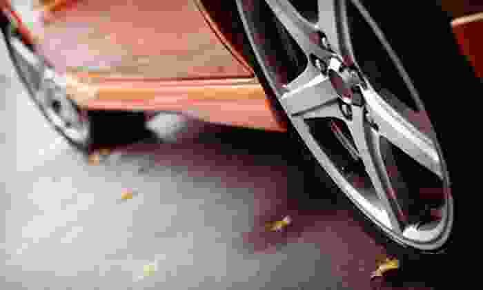 Mac Churchill - Fort Worth: $35 Four-Wheel Alignment at Mac Churchill ($89.95 Value)