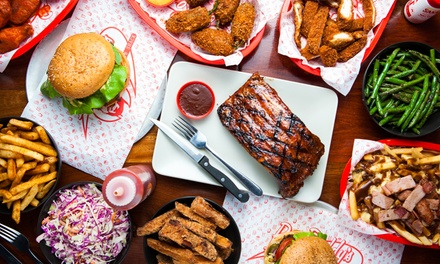 Ribs with Side and Drinks for Two ($49) or Four People ($98) at Big Roddys Rippin Rib Shack (Up to $144 Value)