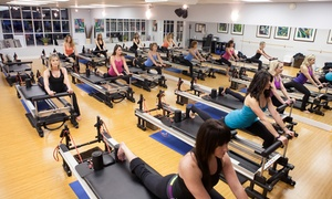IM=X Pilates Lake Oswego: One Private Reformer Lesson with Five or Eight Small-Group Classes at IM=X Pilates Lake Oswego (Up to 79% Off)