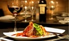 The Village Restaurante Ltd - London: Two- or Three-Course Portuguese Meal with a Glass of Wine for Two or Four at The Village Restaurante (Up to 71% Off)