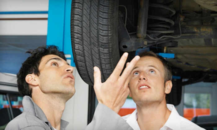 Tuffy Auto Service - Multiple Locations: Oil Change, Tire Rotation, and 41-Point Inspection, or $25 for $50 Worth of Vehicle Services at Tuffy Auto Service