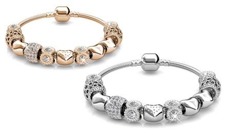 1 o 2 bracciali con cristalli Swarovski® da 18 ct con o senza collana disponibili in 2 colori