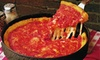 Gino's East - Multiple Locations: $17 for a Medium Deep-Dish Pizza and Appetizer at Gino's East (Up to $37.50 Value)