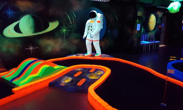 Tee & Putt - Multiple Locations: Glow in the Dark Mini Golf for Two or Four at Tee and Putt (Up to 52% Off)