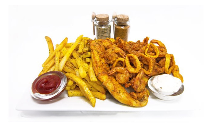 Oak City Fish & Chips - Central Raleigh: $12 for Two Groupons, Each Good for $11 Worth of Seafood at Oak City Fish & Chips ($22Value)