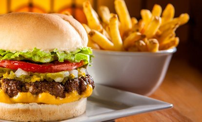 image for One or Two Original Fatburgers with Cheddar and Skin-On Fries at Fatburger (Up to 38% Off)