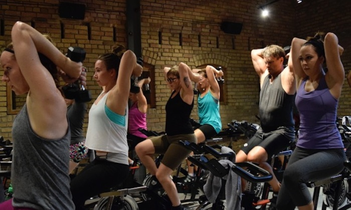 DharmaCycle Yoga - Warehouse District: $49 for One Month of Unlimited Classes at DharmaCycle Yoga ($129 Value)