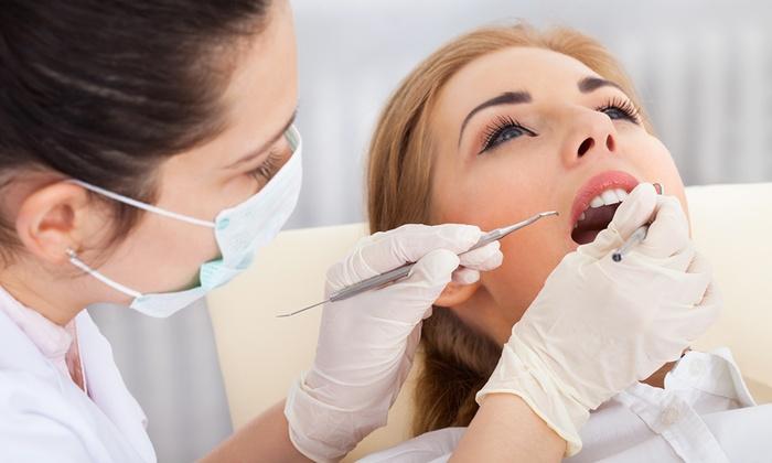 Centro Dentale - Dott Scaravelli Mauro - Cavino: Seduta odontoiatrica con sbiancamento con lampada led e otturazione
