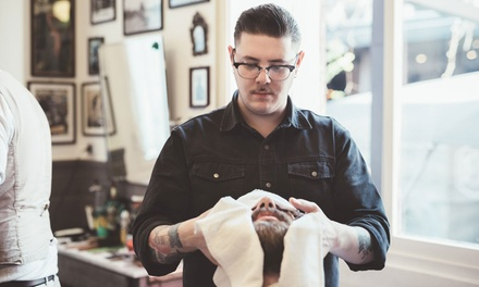 Haircut with Optional Beard Trim, Shave, and Facial Massage at American Barber Institute (Up to 60% Off).