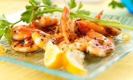 Menu pesce gourmet sul Tevere con bottiglia di vino per 2 o 4 persone da L'Antico Tevere (sconto fino a 63%)