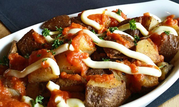 Tapa Vino - Downtown: C$30 for C$50 Worth of Mediterranean Tapas and Drinks for Two or More at Tapa Vino. Groupon Reservation Required.