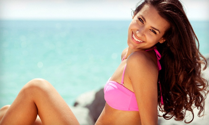 E-Z Tan - Multiple Locations: One Month of Unlimited Spray and UV Tanning or Three Sunless Tans at E-Z Tan (Up to 79% Off)