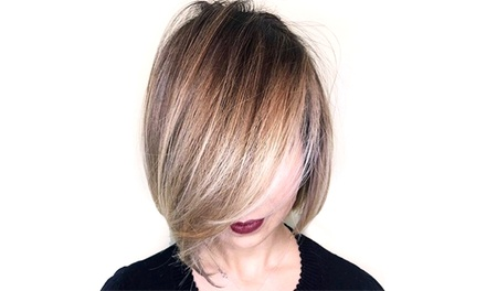 Haircut and Style with Optional All-Over Color and Partial Highlights at Sola Salon (Up to 52% Off)