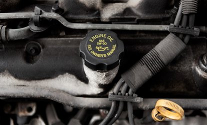 image for Standard or Synthetic Oil Change, Brake Service, or Transmission Fluid Replacement at Midas (Up to 75% Off)