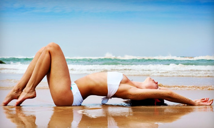 Aztec Tan - San Diego: 5 Mystic Tan Spray Tans or 10 Level 4 Bronzing Tanning-Bed Sessions at Aztec Tan (Up to 73% Off)