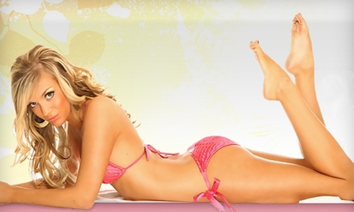 L.A. Tan - Multiple Locations: Booth or Bed Tan, a Spray Tan, or a Teeth-Whitening Kit at L.A. Tan (Up to 73% Off)
