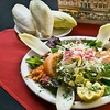 Up to 51% Off Belgian-American Fare at The Broken Spoke Cafe