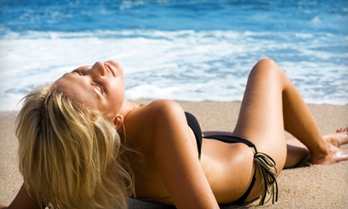 Suns A Beach Tanning Shop - Rio Grande: $25 for Two Spray Tans or 10 Wolff-Level Bed Tans at Suns A Beach Tanning Shop (Up to $50 Value)