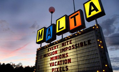 Two Movie Tickets and One Medium Popcorn at Malta Drive-In Theatre (Up to 58% Off)