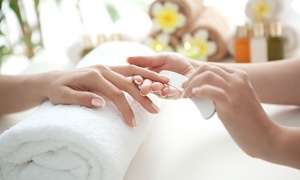 Manhattans Salon and Spa: Regular or Gel Manicures with Spa or Deluxe Pedicures at Manhattans Salon and Spa (Up to 67% Off)