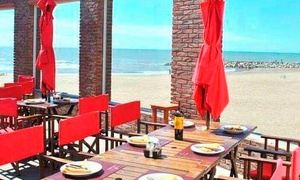 Puerto Cardiel Asador  Restaurante: Desde $199 por rabas + papas fritas + cerveza de litro para dos o cuatro en Puerto Cardiel Restaurante