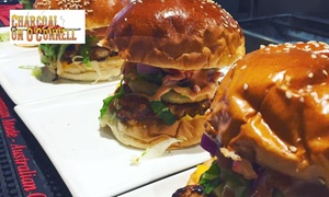 Charcoal On O'Connell: Choice of Gourmet Burger with Small Fries for One ($15) or Two People ($29) at Charcoal On O'Connell (Up to $44 Value)