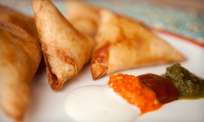 African Grill and Bar - Aurora Hills: $10 for $20 Worth of African Cuisine at African Grill and Bar