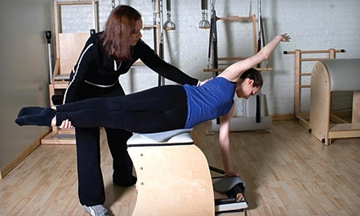 Pilates at Quads - Chicago: $99 for Three Private Training Sessions at Pilates at Quads (Up to $210 Value)