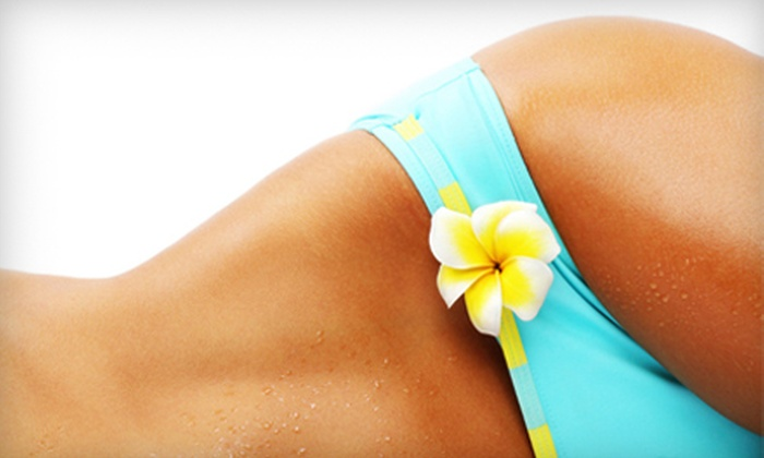 Mujeres Salon and Spa - Market District: Three Mystic Spray Tans or 110 Total Minutes of UV Tanning at Mujeres Salon and Spa