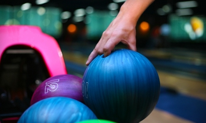 Manhattan Lanes - De Pere: $20 for Eight Games of Bowling, Four Shoe Rentals, a Large Pizza, and a Pitcher of Soda at Manhattan Lanes ($41 Value)