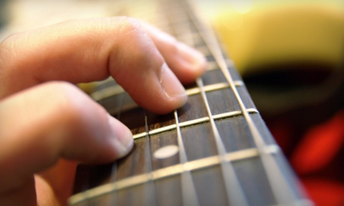 American Guitar Academy - Multiple Locations: Four Private Guitar Lessons for One or Two from American Guitar Academy (Up to 58% Off)