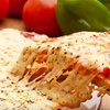$10 for Pizza and More at Pudge Bros. Pizza