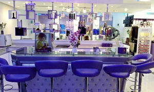 Donna Ricci: Gelish Manicure and Pedicure Packages with Optional Paraffin Treatment and Facial at Donna Ricci (Up to 69% Off)