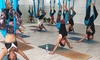 YogaBar - Multiple Locations: $15 for 2 Weeks of Unlimited Yoga, Barre or Pilates Classes at Choice of 8 Locations with YogaBar (Up to $35 Value)