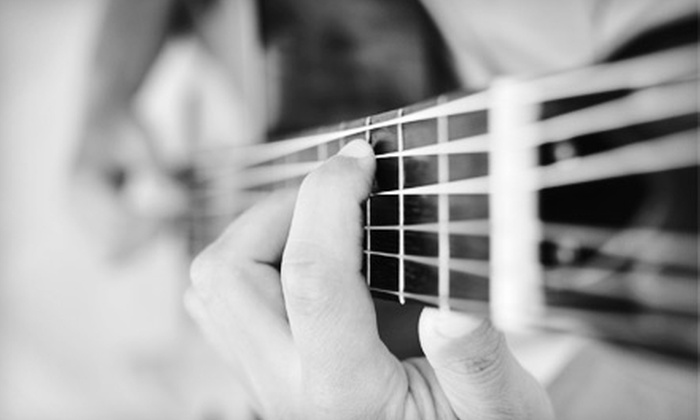 The Musicology - Northwest Side: $40 for Four 30-Minute Music Lessons on Guitar, Bass Guitar, or Drums at The Musicology ($90 Value)