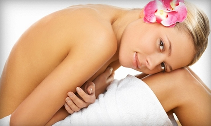 Exotic Tans - Multiple Locations: $69 for Two Fit Body-Wrap Treatments at Exotic Tans ($200 Value). Three Locations Available.