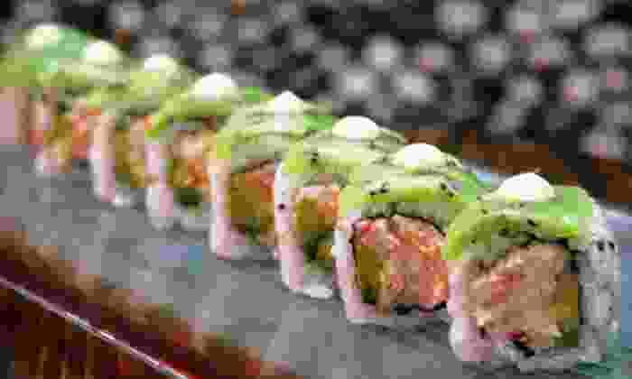 Amber - Upper East Side: $34 for Deluxe Sushi Dinner for Two at Amber Sushi Including Two Specialty Rolls, Two Regular Rolls and Two Cocktails (Up to $78 Value)