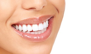 Al Reem Dental Clinic: Clean, with Scale and Polish, Tooth Extraction or One Filling, or Teeth Whitening Session at Al Reem Dental Clinic