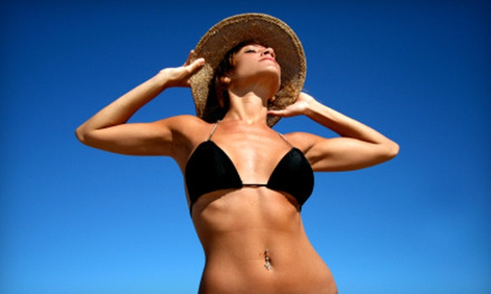 Sun Care Spray Tan & Skin Care Salon - Multiple Locations: $29 for Two-Week Tanning and Red-Light Therapy Package at Sun Care Spray Tan & Skin Care Salon ($128.99 Value)