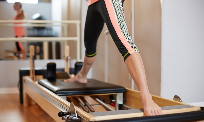 White House Pilates - Multiple Locations: Two, Three, or Four Pilates Reformer Classes at White House Pilates (Up to 73% Off)