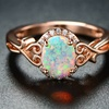 White Fire Opal Filigree Ring by Peermont