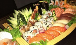 Sushi Kamii: Sushi Kamii cena con antipasto, barca di sushi e sashimi fino a 82 pezzi e birra per 2 o 4 persone (sconto 61%)