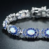 Sapphire and White Fire Opal Alternating Tennis Bracelet