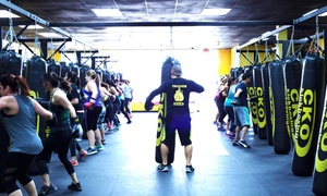 CKO Kickboxing: Three or Six Classes or One Month of Unlimited Classes and One Pair of Gloves at CKO Kickboxing (Up to 86% Off)