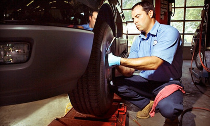 Merlin 200,000 Mile Shop - Naperville: Oil Change Packages or Four-Wheel Alignment at Merlin 200,000 Mile Shop (Up to 64% Off). Four Options Available.